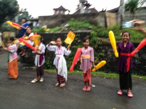 The children of the villagers dressed in traditional outfits.